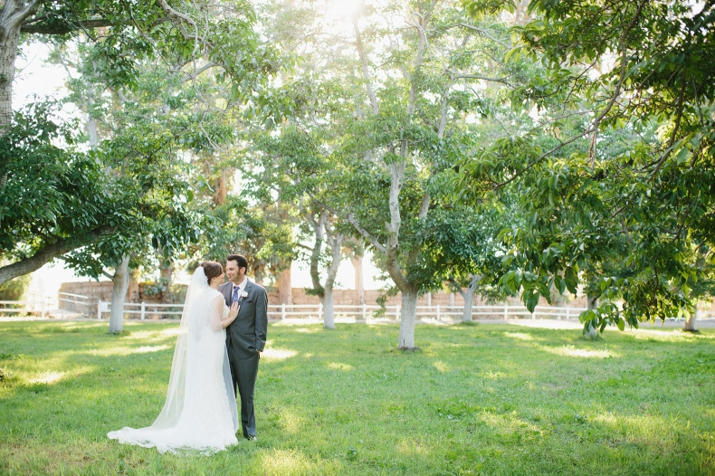 The couple surrounded by trees.