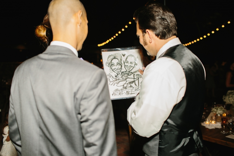 The groom looking at a drawing.