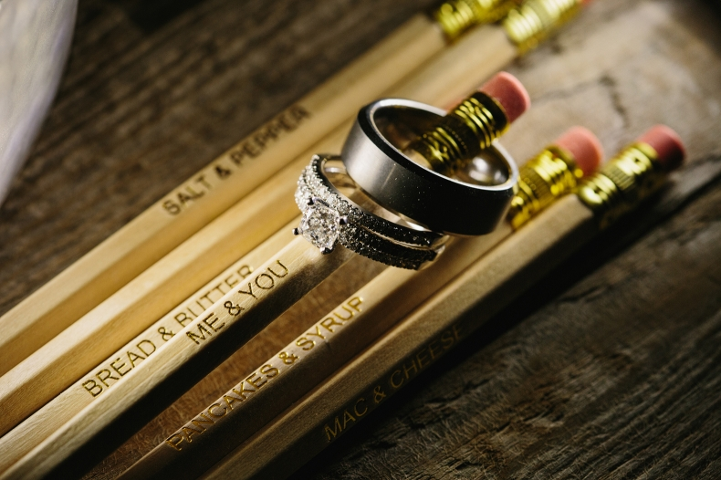 The wedding rings on a pencil.