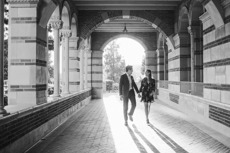 A black and white photo of the couple walking.