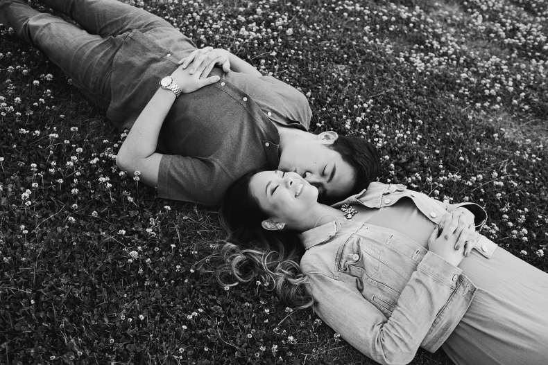 A black and white photo of the couple on the grass.